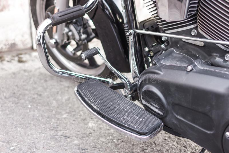 Comfortable position legs on the motorcycle footboard. Solid step up. Gear shift pedal. Chrome parts. Heavy classic motorcycle. Comfortable position legs stock photos