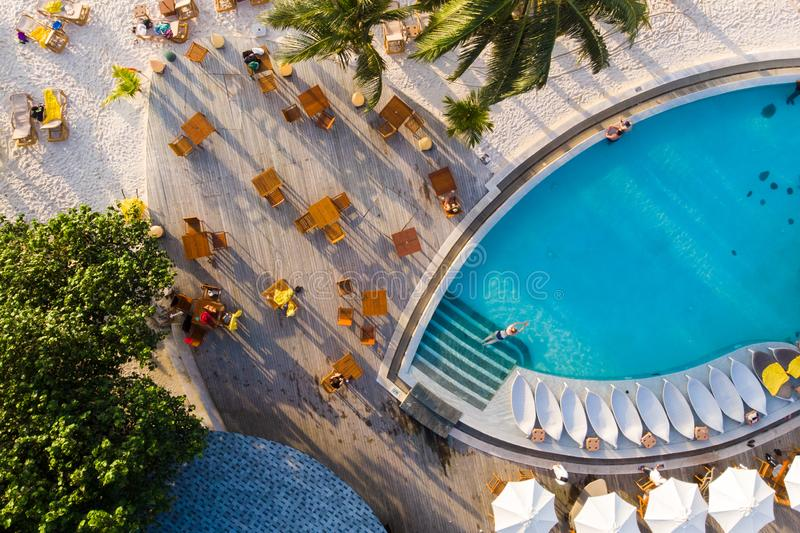 Comfortable resort on a tropical island, beautiful swimming pool and sunbeds with umbrellas stock photography