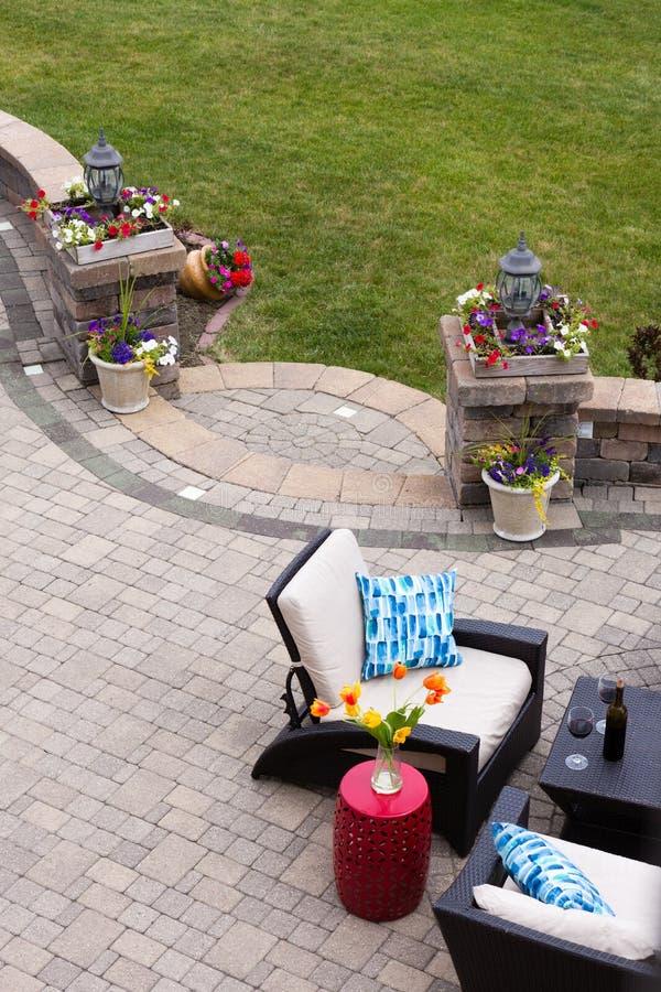 Comfortable Seating on Luxury Stone Patio stock photos