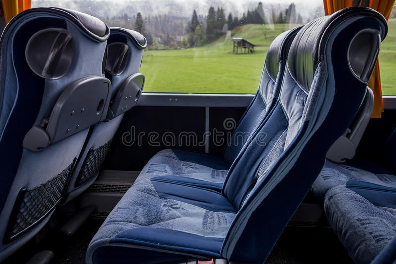Comfortable seats in a bus royalty free stock photo
