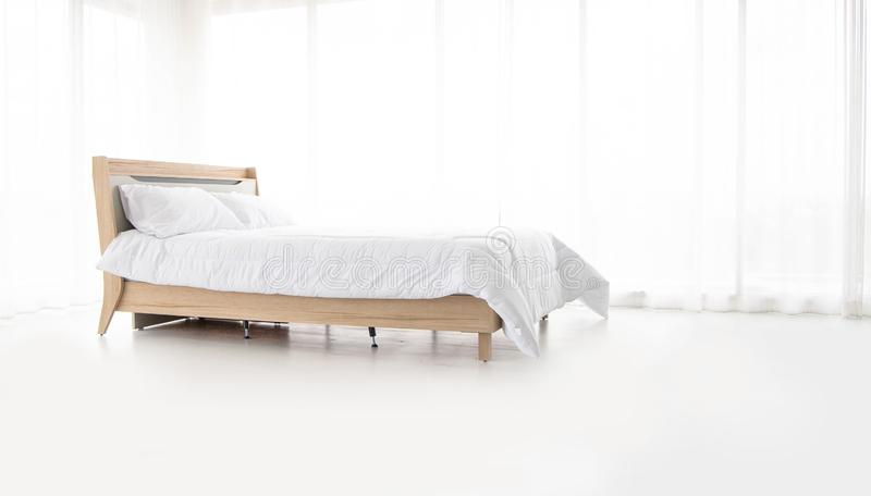 Comfortable sleeping bed Relaxing in the bedroom Backdrop of white  room curtains royalty free stock photography