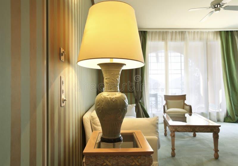 Comfortable suit, closeup table lamp stock photography