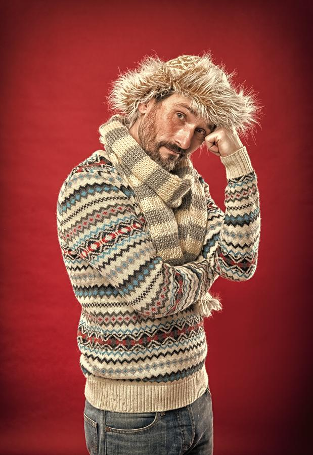 Comfortable and warm. Mature fashion model in cold weather style. A winter set protects him from cold. Bearded man. Accessorizing sweater with hat and scarf stock photos