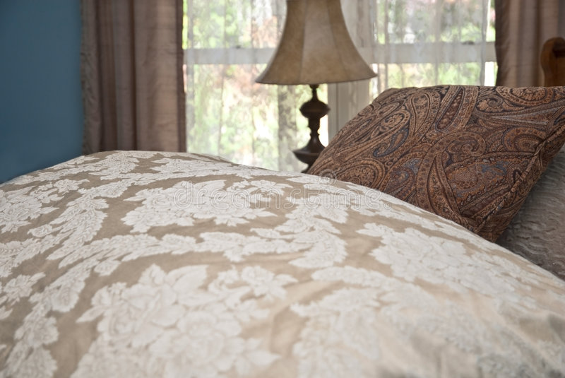 Comforter and Pillows on Bed royalty free stock images
