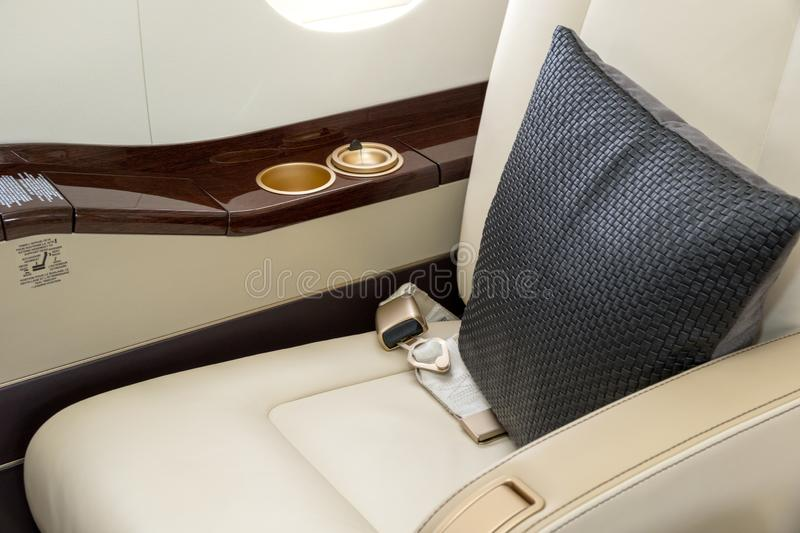 chairs in a modern business jet airplane royalty free stock images