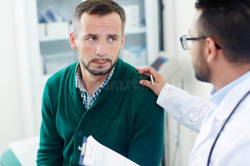 Comforting patient stock image