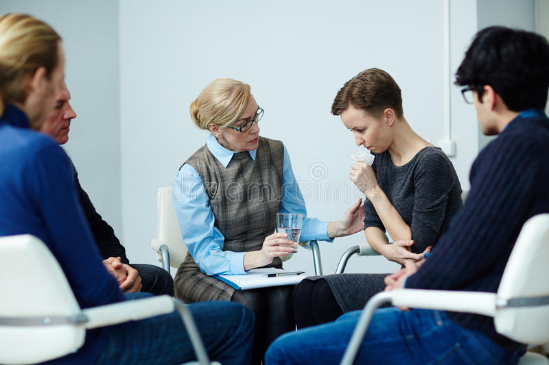 Comforting Patient in Support Group stock photos