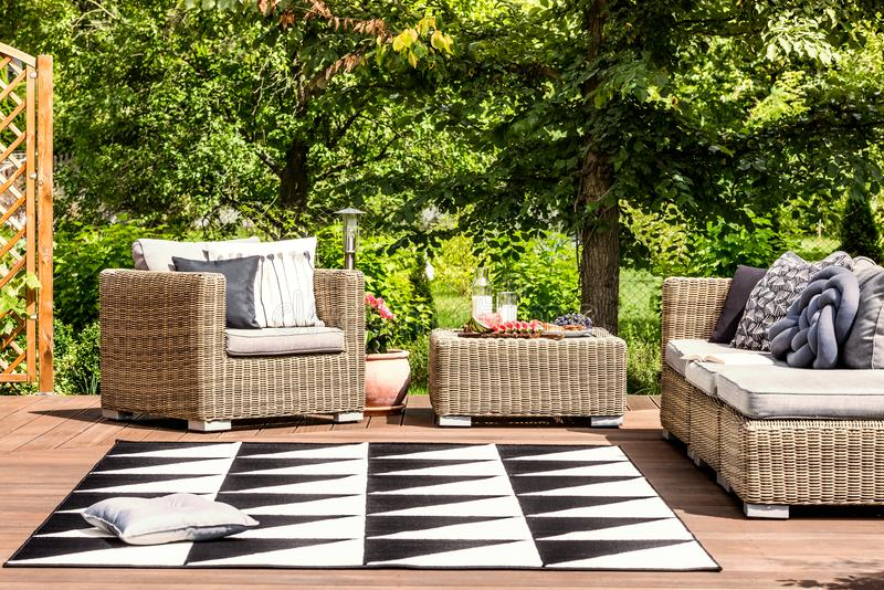 Garden furniture and rug royalty free stock images