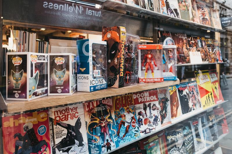 Comic books on a window retail display of Gosh! Comics shop in Covent Garden, London, UK stock photos