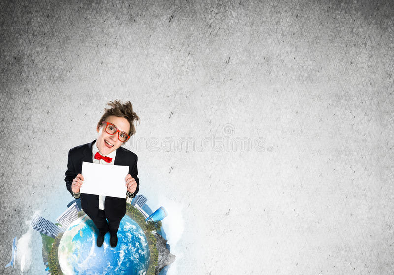 Comic businessman on Earth top. Top view of funny businessman in red glasses showing blank paper sheet. Elements of this image are furnished by NASA royalty free stock photos