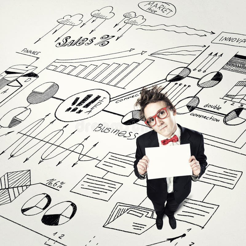 Comic man with banner. Top view of funny businessman holding blank paper sheet stock photo