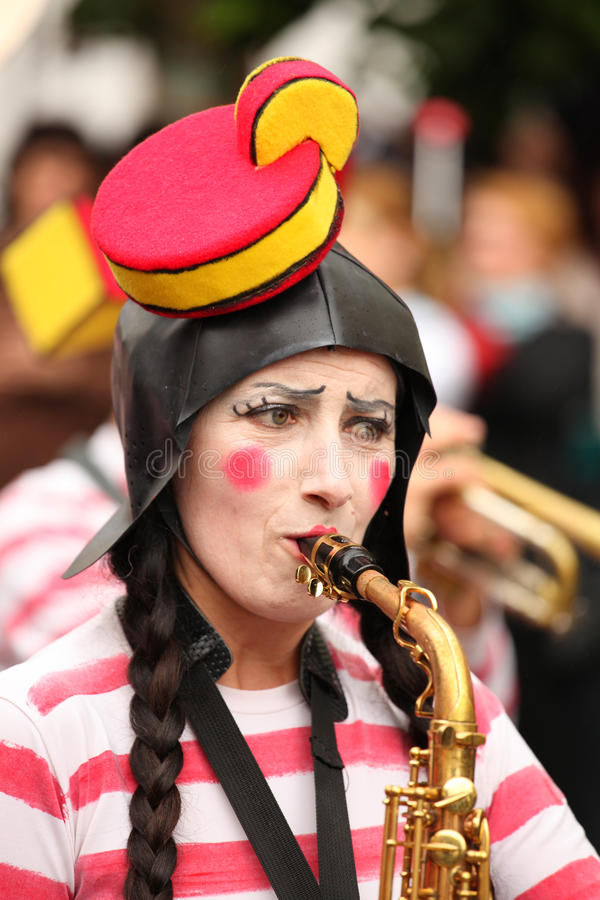 Comic woman playing saxophone royalty free stock photo