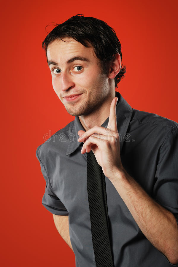 Comic young man on red stock photos