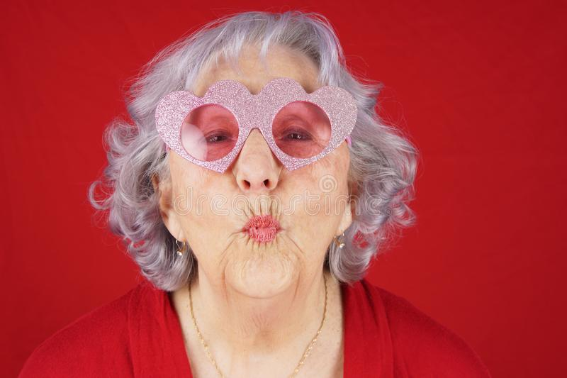 Comical granny with heart shape glasses royalty free stock image