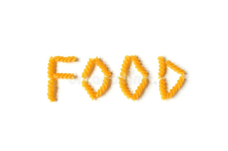 Comida aislada de la palabra hecha de las pastas amarillas del trigo duro en un backgro blanco fotos de archivo libres de regalías