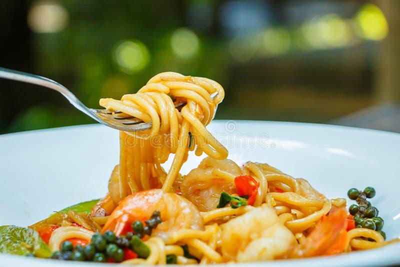 Comida, espagueti en cafetería imágenes de archivo libres de regalías