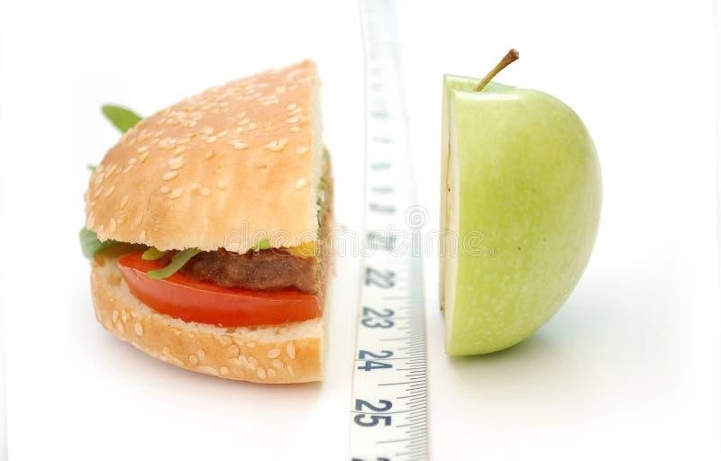 Comida lixo ou fruta? foto de stock royalty free