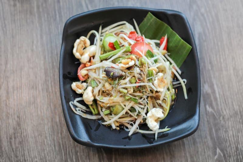 Comida tradicional tailandesa o nombre de la ensalada de la papaya en Somtum tailandés imágenes de archivo libres de regalías
