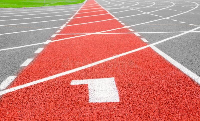 Comience la pista Carriles 1 número uno en competir con rojo fotografía de archivo