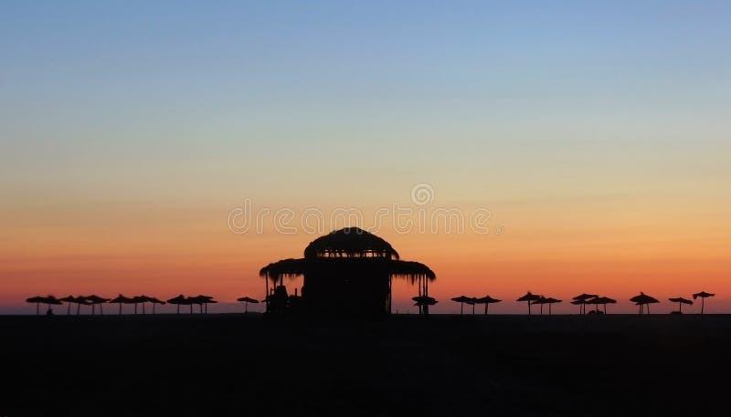 Cominci il vostro giorno sulla spiaggia fotografia stock libera da diritti