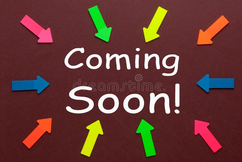 Coming Soon Concept. Colorful arrows pointing to text `Coming Soon`. Business Concept royalty free stock photos