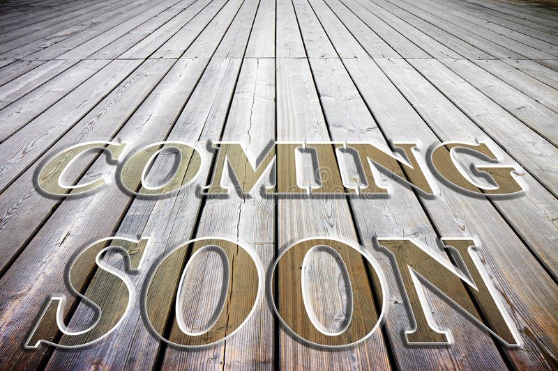 Coming soon concept written on a wooden floor. Slats royalty free stock photography