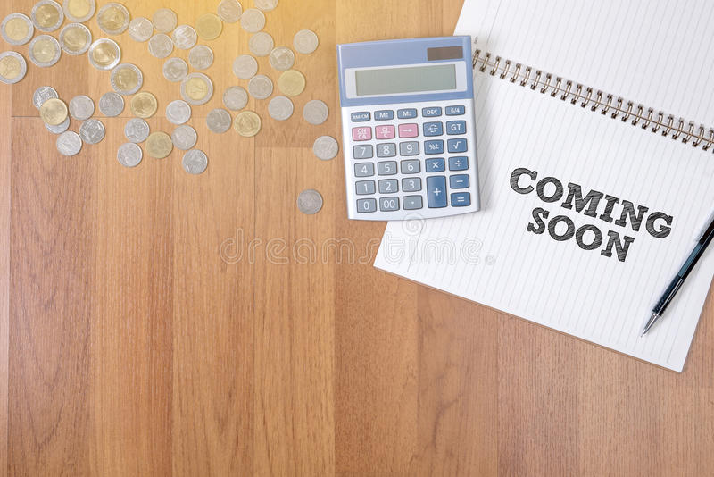 COMING SOON. A finance Money, calculator notes, calculator top view work royalty free stock photography
