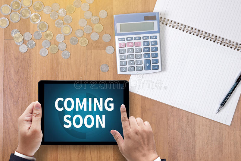 COMING SOON. A finance Money, calculator notes, calculator top view work stock photos