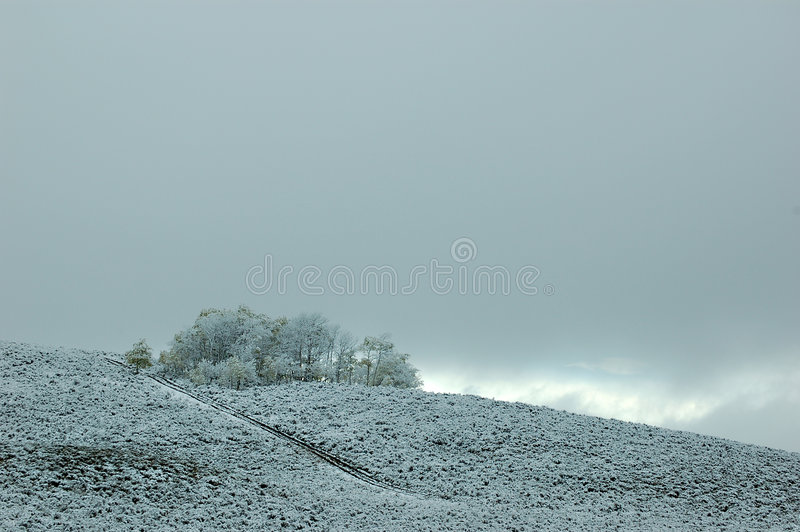 Coming Storm. Snowstorm over rolling hills in Wyoming royalty free stock images