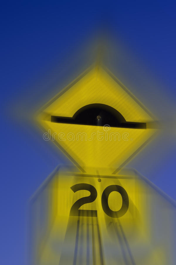 Coming up fast. Image series: Australia out doors: Abstract yellow road signs. An artistic concept of speed and road safety stock photography