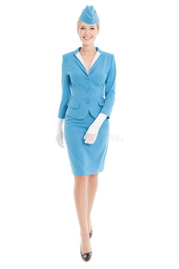 Comissária de bordo encantador In Blue Uniform no fundo branco fotos de stock royalty free