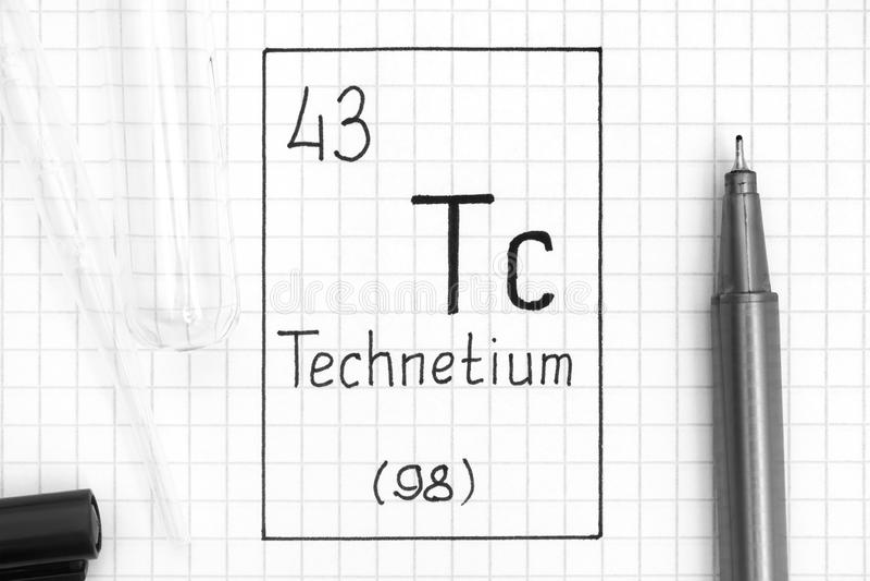 Comité technique de technétium d'élément chimique d'écriture avec le stylo, le tube à essai et la pipette noirs photographie stock libre de droits