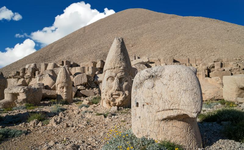 Commagene statues on the summit of Mount Nemrut in Adiyaman, Turkey. Commagene statue ruins on top of Nemrut Mountain in Adiyaman, Turkey. Stone heads at the top stock photography