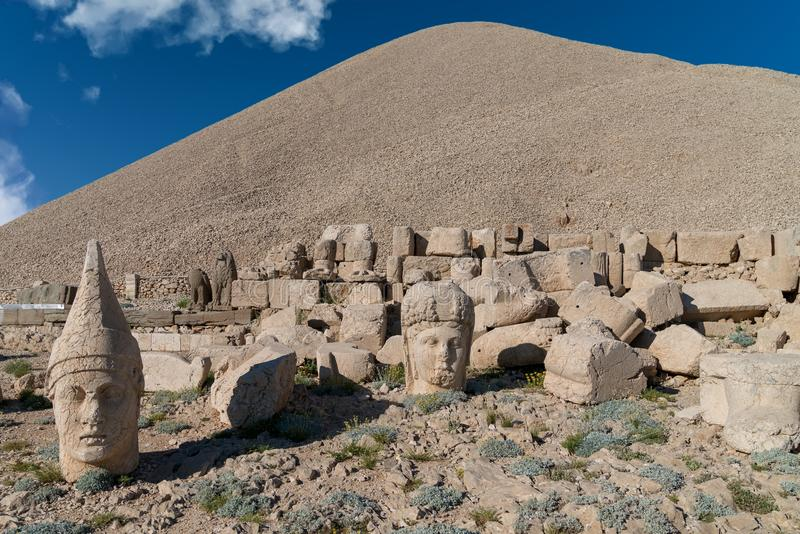 Commagene statues on the summit of Mount Nemrut in Adiyaman, Turkey. Commagene statue ruins on top of Nemrut Mountain in Adiyaman, Turkey. Stone heads at the top royalty free stock photos