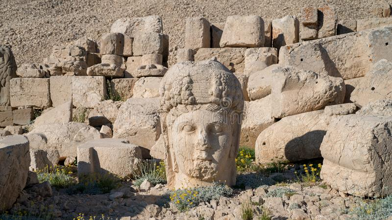 Commagene statues on the summit of Mount Nemrut in Adiyaman, Turkey. Commagene statue ruins on top of Nemrut Mountain in Adiyaman, Turkey. Stone heads at the top stock photo