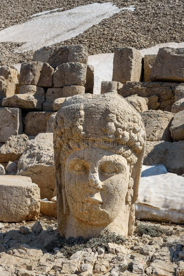 Commagene statue at WestTerrace on top of Nemrut Mountain.Turkey. Commagene statue at West Terrace on top of Nemrut Mountain. Stone heads at the top of 2150 stock photo