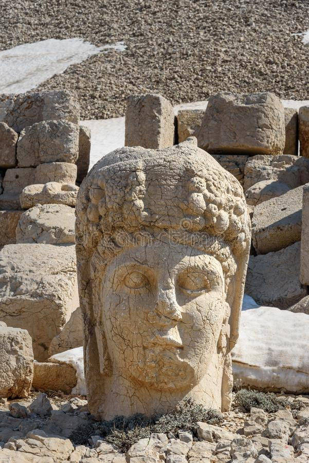 Commagene statue at WestTerrace on top of Nemrut Mountain.Turkey. Commagene statue at West Terrace on top of Nemrut Mountain. Stone heads at the top of 2150 royalty free stock photos