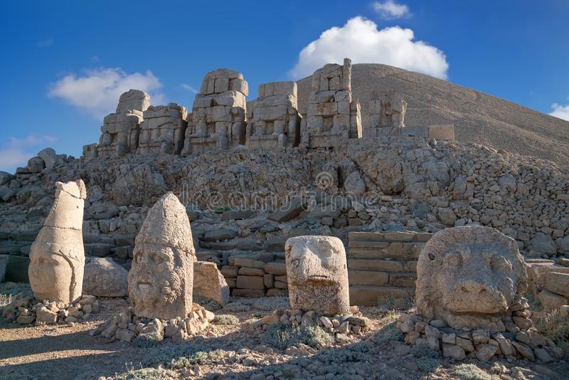 Commagene statues on the summit of Mount Nemrut in Adiyaman, Turkey. Commagene statue ruins on top of Nemrut Mountain in Adiyaman, Turkey. Stone heads at the top royalty free stock image