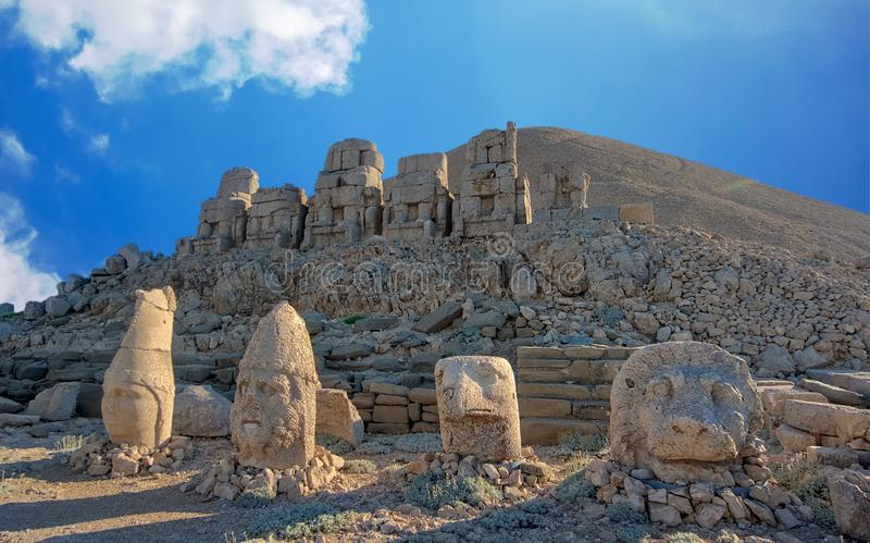 Commagene statues on the summit of Mount Nemrut in Adiyaman, Turkey. Commagene statue ruins on top of Nemrut Mountain in Adiyaman, Turkey. Stone heads at the top royalty free stock photography