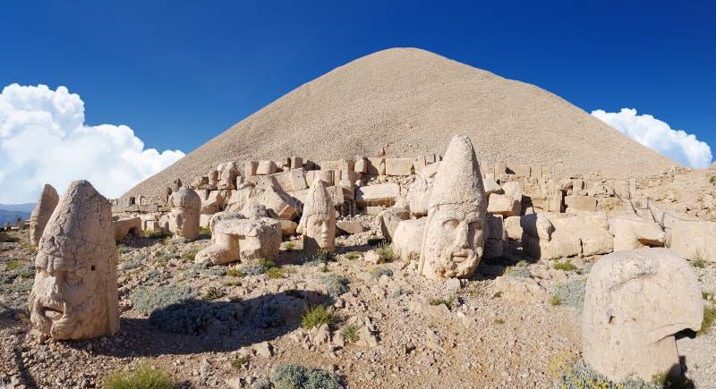 Commagene statues on the summit of Mount Nemrut in Adiyaman, Turkey. Commagene statue ruins on top of Nemrut Mountain in Adiyaman, Turkey. Stone heads at the top stock photos