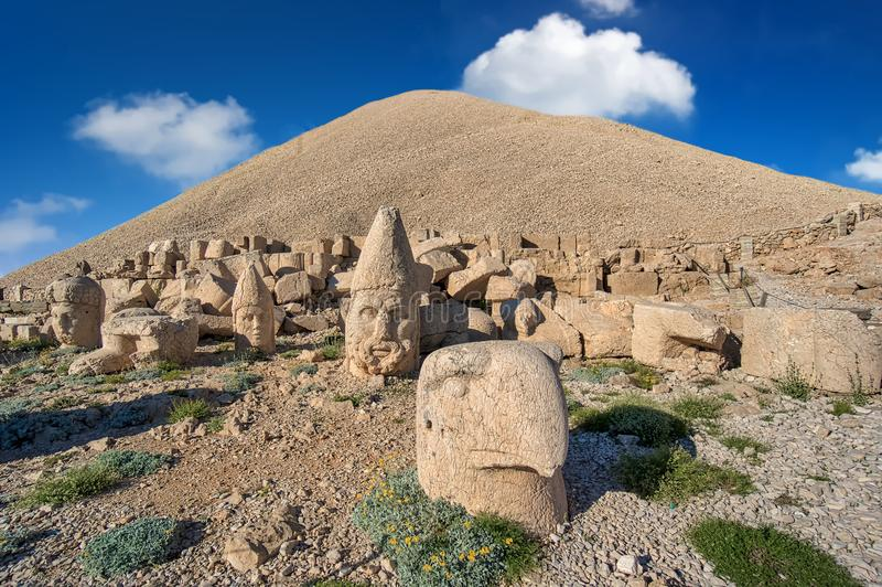 Commagene statues on the summit of Mount Nemrut in Adiyaman, Turkey. Commagene statue ruins on top of Nemrut Mountain in Adiyaman, Turkey. Stone heads at the top royalty free stock photo