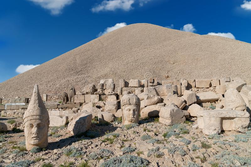 Commagene statues on the summit of Mount Nemrut in Adiyaman, Turkey. Commagene statue ruins on top of Nemrut Mountain in Adiyaman, Turkey. Stone heads at the top stock image