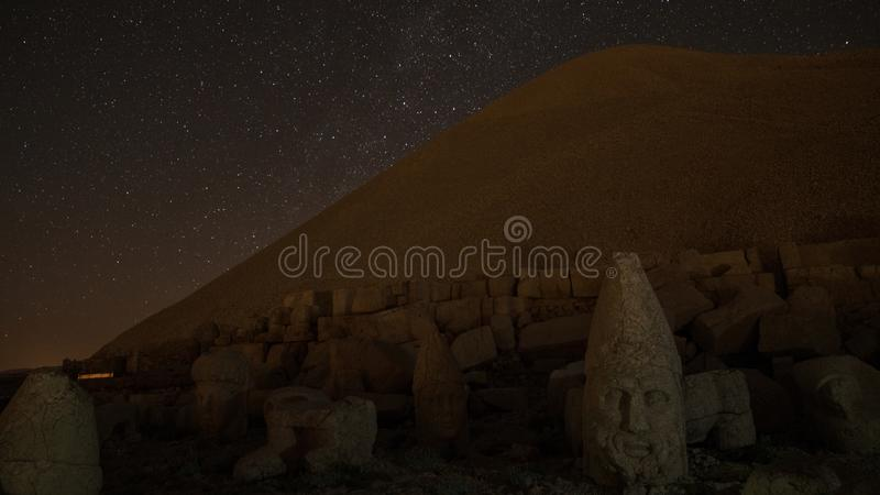 Commagene statues on the summit of Mount Nemrut at night with stars in the sky, Adiyaman, Turkey. Stone heads at the top of 2150 meters high Mount Nemrut royalty free stock images
