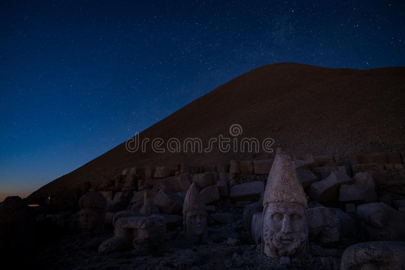 Commagene statues on the summit of Mount Nemrut at night with stars in the sky, Adiyaman, Turkey. Stone heads at the top of 2150 meters high Mount Nemrut stock photography