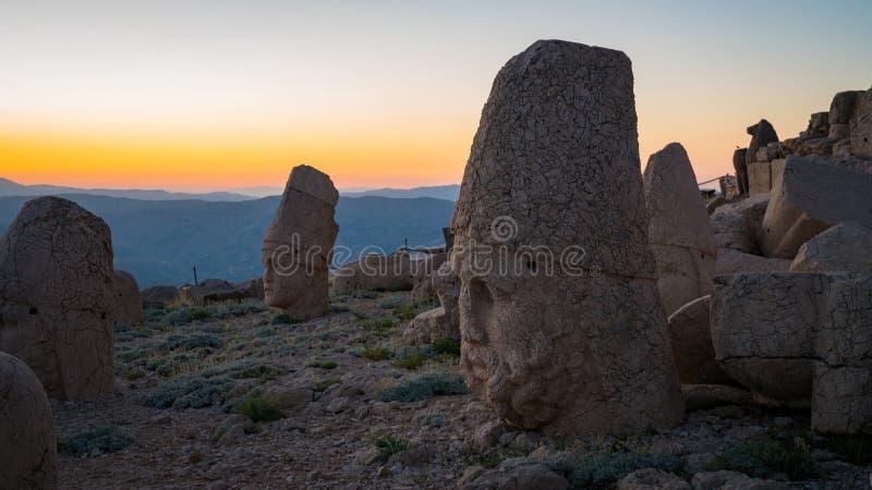 Commagene statues on the summit of Mount Nemrut during sunset in Adiyaman, Turkey. Commagene statue ruins on top of Nemrut Mountain in Adiyaman, Turkey. Stone stock photos