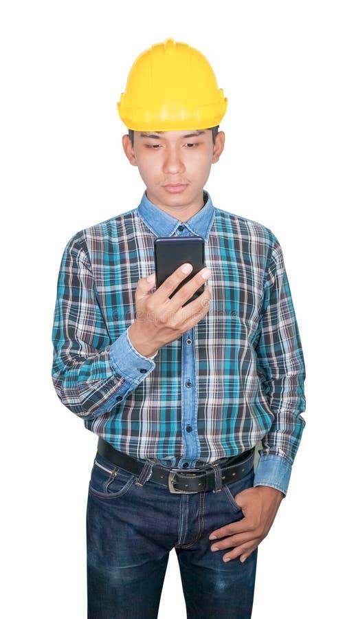 Commande d'entretien d'ing?nieur d'homme d'affaires avec le t?l?phone portable avec 5g le r?seau, Internet mobile ultra-rapide et photos libres de droits