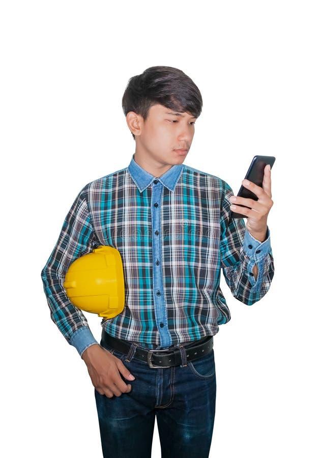 Commande d'entretien d'ing?nieur d'homme d'affaires avec le t?l?phone portable avec un r?seau 5g, Internet mobile ultra-rapide et image libre de droits