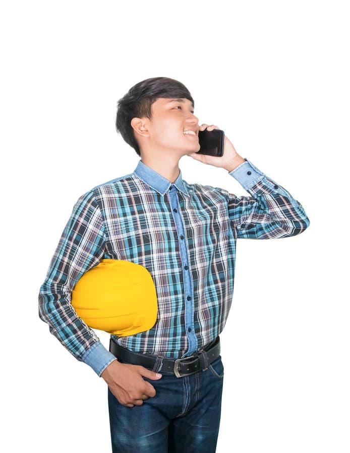 Commande d'entretien d'ing?nieur d'homme d'affaires avec le t?l?phone portable avec un r?seau 5g, Internet mobile ultra-rapide et photographie stock libre de droits