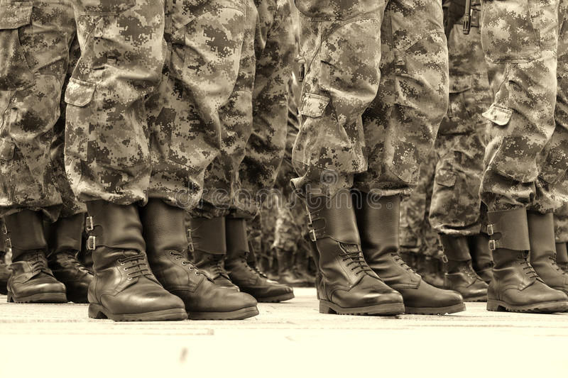 Commandos in a row. Lines of commando soldiers in camouflage uniforms royalty free stock photos