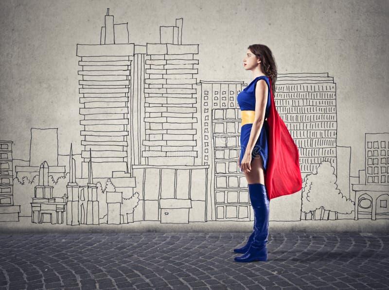 Comme une superwoman images libres de droits